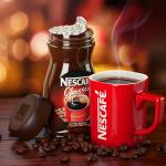 фото красной чашки кофе нескафе